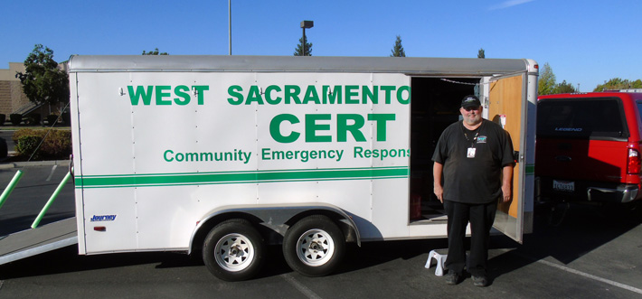 Randall Frank, CERT member and Property Manager with the CERT utility trailer.